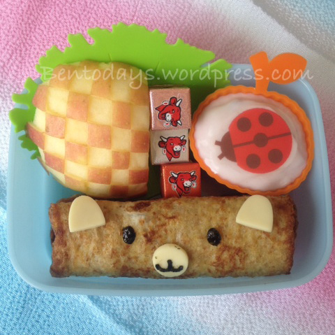 Easy french toast with bear decoration. Sides of yoghurt, cheese cubes and apple