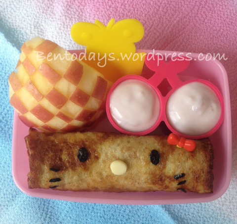 Easy french toast with Hello Kitty decoration. Sides of yoghurt, cheese cubes and apple