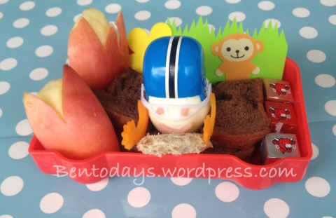 Racing theme bento. Race car drivers lunch bento. Egg topped with helmet.