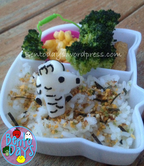 cute Zebra lunch bento made of quail eggs and fishball, with furikake and rice