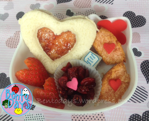 Cute lunch bento for kids - Tea party themed bento for Valentines Day. Jam tart heart sandwiches and pink cupcakes