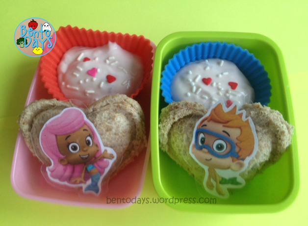 Simple breakfast bento for preschoolers. Yoghurt, heart shaped sealed sandwich, Bubble Guppies decoration