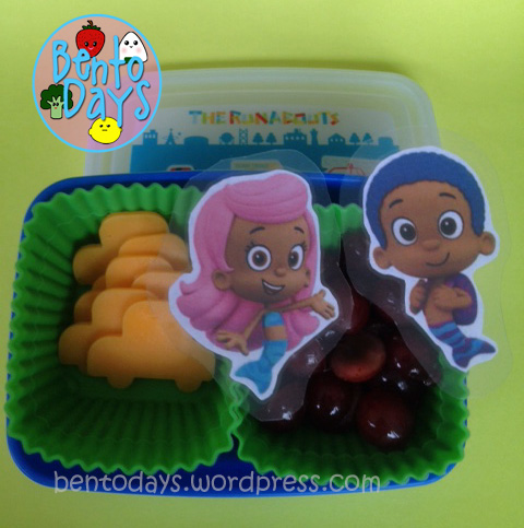 Baby's first bento, cheese and grapes with Bubble Guppies decoration