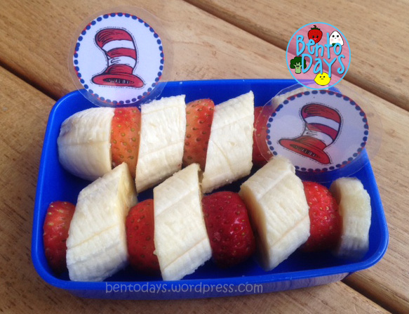 Dr Seuss themed snack for read Across America Day (Dr Seuss Day), based on the Cat in the Hat, Features strawberries and bananas.