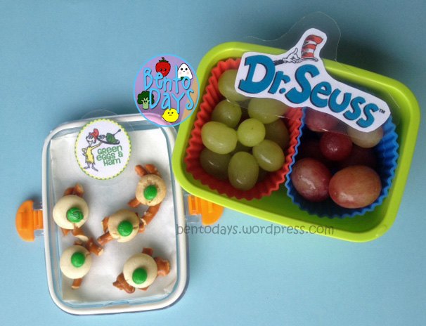 "Dr Seuss themed snack for read Across America Day (Dr Seuss Day), based on  ""Green Eggs and ham"" and Bar Ba Loots Truffula Fruits from ""The Lorax"". Green eggs are green M&Ms on top of white chocolate,  Truffula Fruits are grapes."