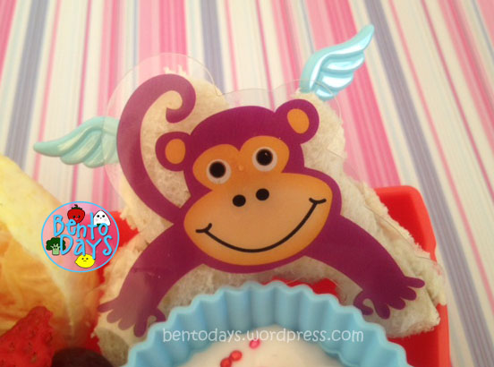 Cute lunch bento for kids: Oz - The Great and Powerful: Flying Monkey peanut butter sandwich and Wilton Cake Pop decoration