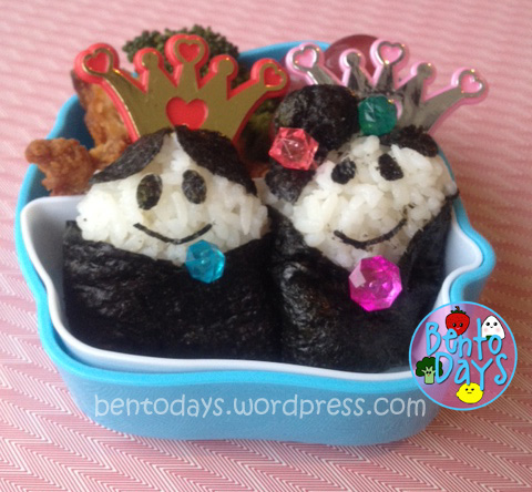 Cute lunch bento for kids - Hinamatsuri bento (Girls Day) made of onigiri, containing the Emperor and Empress.