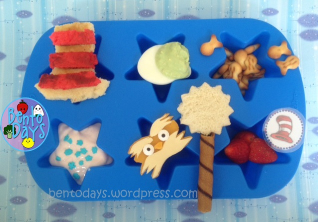 cute lunch bento for kids for Dr Seuss Day (Dr Seuss's birthday).  Dr Seuss lunch in a muffin tray, features classics like the Cat in a Hat, Green Eggs, One Fish Two Fish, the Lorax, and more!