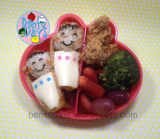 cute lunch bento for kids - sleeping babies (onigiri) in inari cradle. Cheese blankets and tamago.