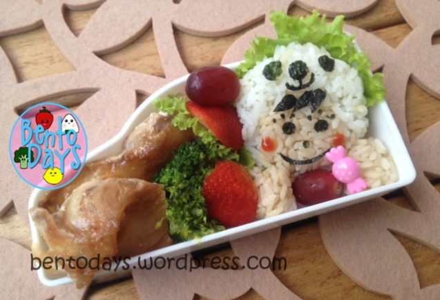 Onigiri bento lunch of boy wearing panda hat