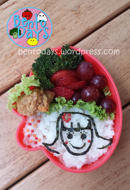 Sketch of a girl (nori outlines) lunch bento