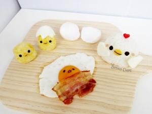 Humorous Gudetama food art bento