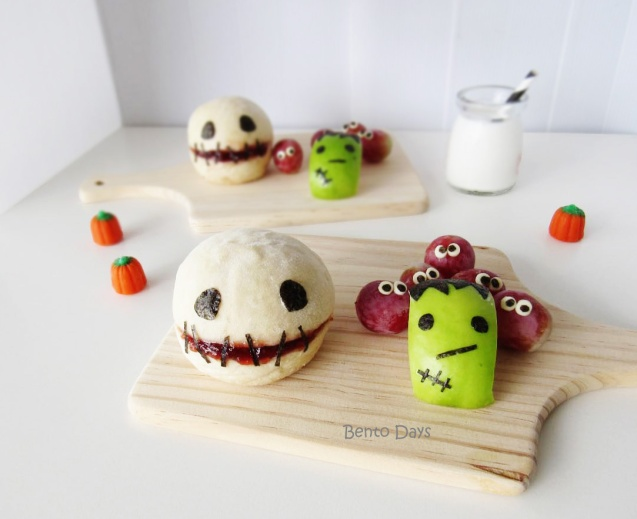 Halloween skull bread buns with Frankenstein apples and monster grapes